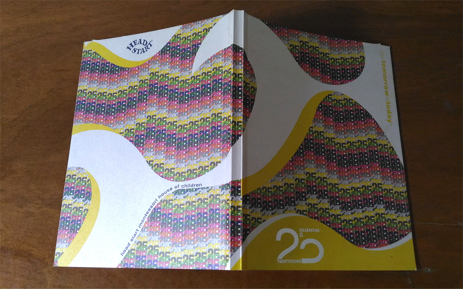 Head Start Montessori House of Children, book celebrating 25 years. Front and back cover spread.